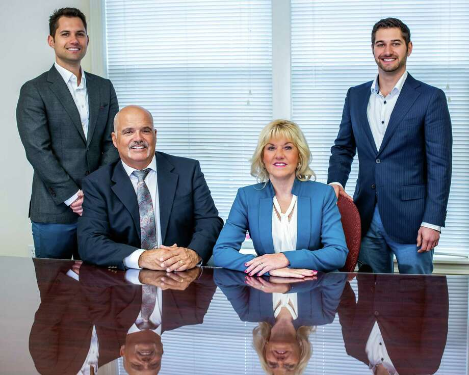 From left, Mario D'Aquila, Ron D'Aquila, Sharon D'Aquila and Nick D'Aquila lead their family-owned and operated home health care company Assisted Living Services. Photo: Contributed Photo / RC Imaging        Photography