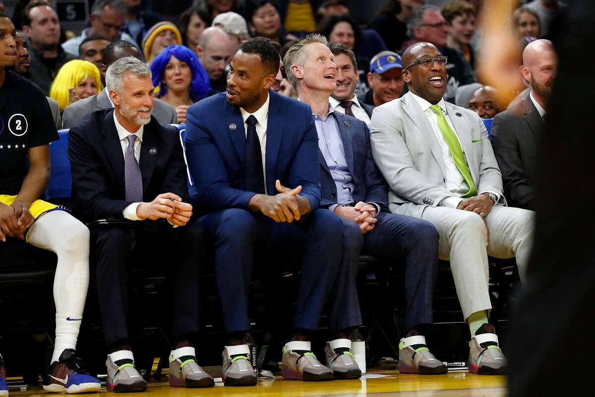 Golden State Warriors' coaches' Bruce Fraser, Jarron Collins, Steve Kerr and Mike Brown all wear Kobe Bryant's shoes during 125-120 loss to Los Angeles Lakers during NBA game at Chase Center in San Francisco, Calif., on Saturday, February 8, 2020.