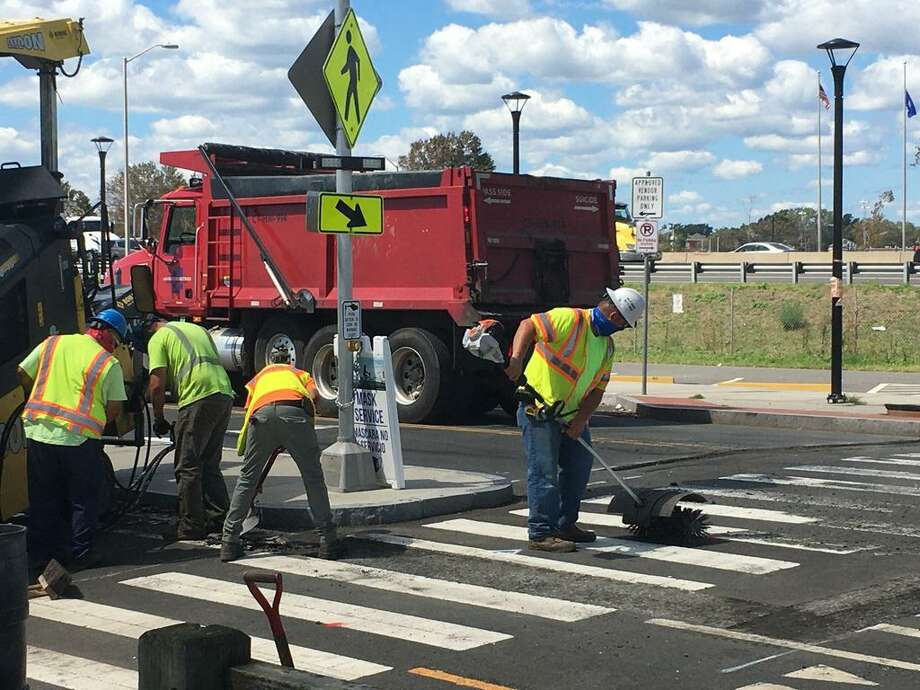 Crews worked to install three raised crosswalks on Long Wharf Drive Thursday. Mayor Justin Elicker previously said the city was exploring ways to deter street racing in the area. Photo: Meghan Friedmann / Hearst Connecticut Media