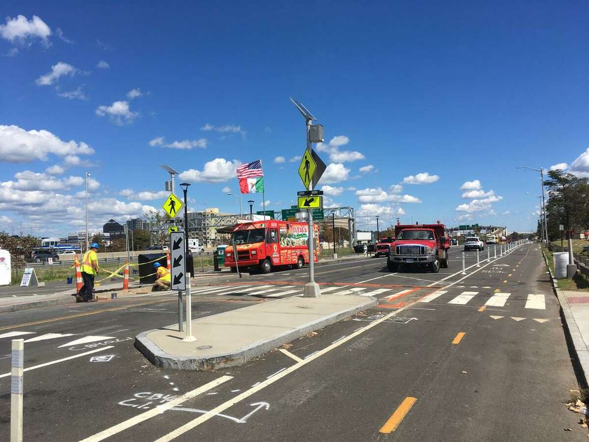 Crews worked to install three raised crosswalks on Long Wharf Drive Thursday. Mayor Justin Elicker previously said the city was exploring ways to deter street racing in the area.