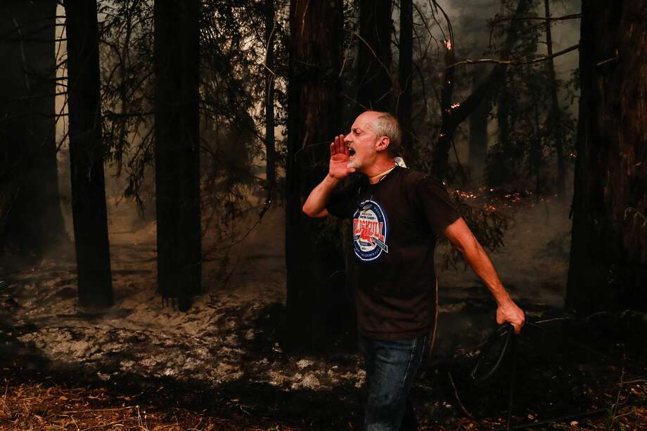 Robert Caldeira tries to get a hose turned on as he attempts to put out some spot fires on Pine Flat Road in Bonny Doon, Calif., on Wednesday, Aug. 19, 2020. Photo: MediaNews Group/The Mercury News/MediaNews Group Via Getty Images / Bay Area News Group - Digital First Media
