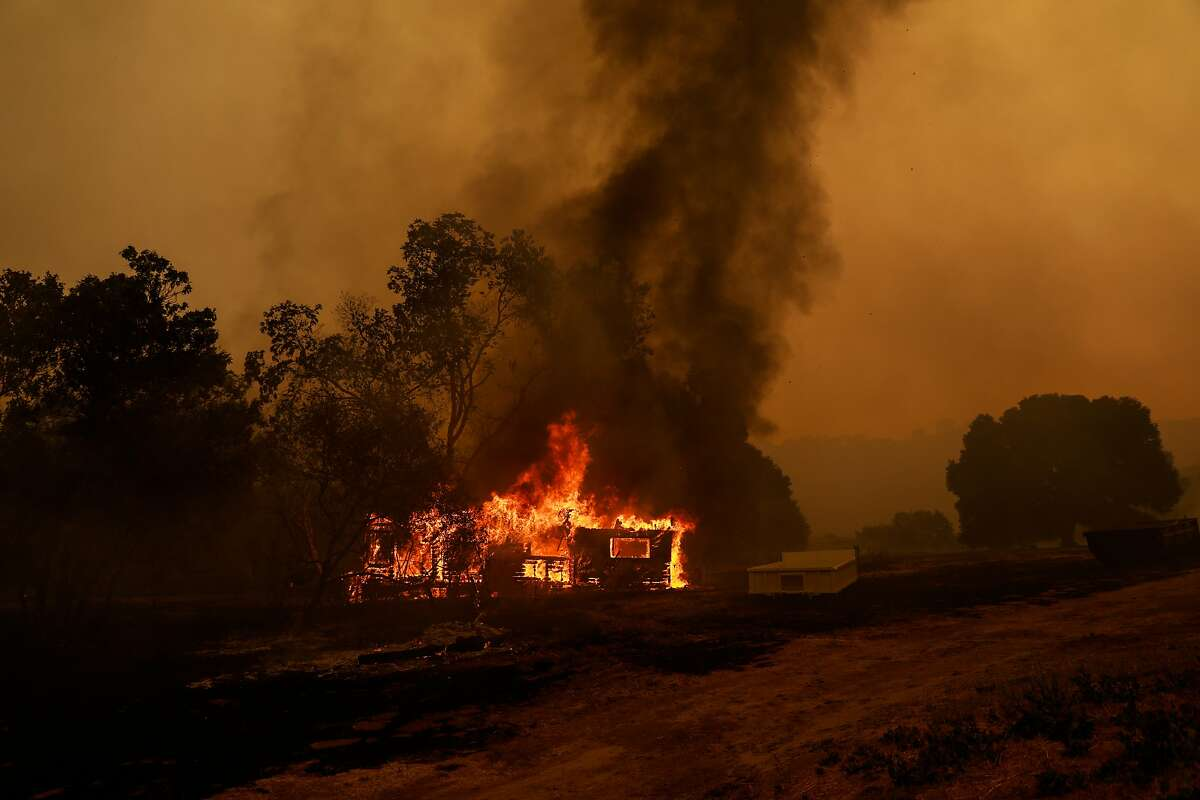 A structure burns off of Pleasants Valley Road during the LNA Lightning Complex Fire in Vacaville , Calif., on Wednesday, August 19, 2020.