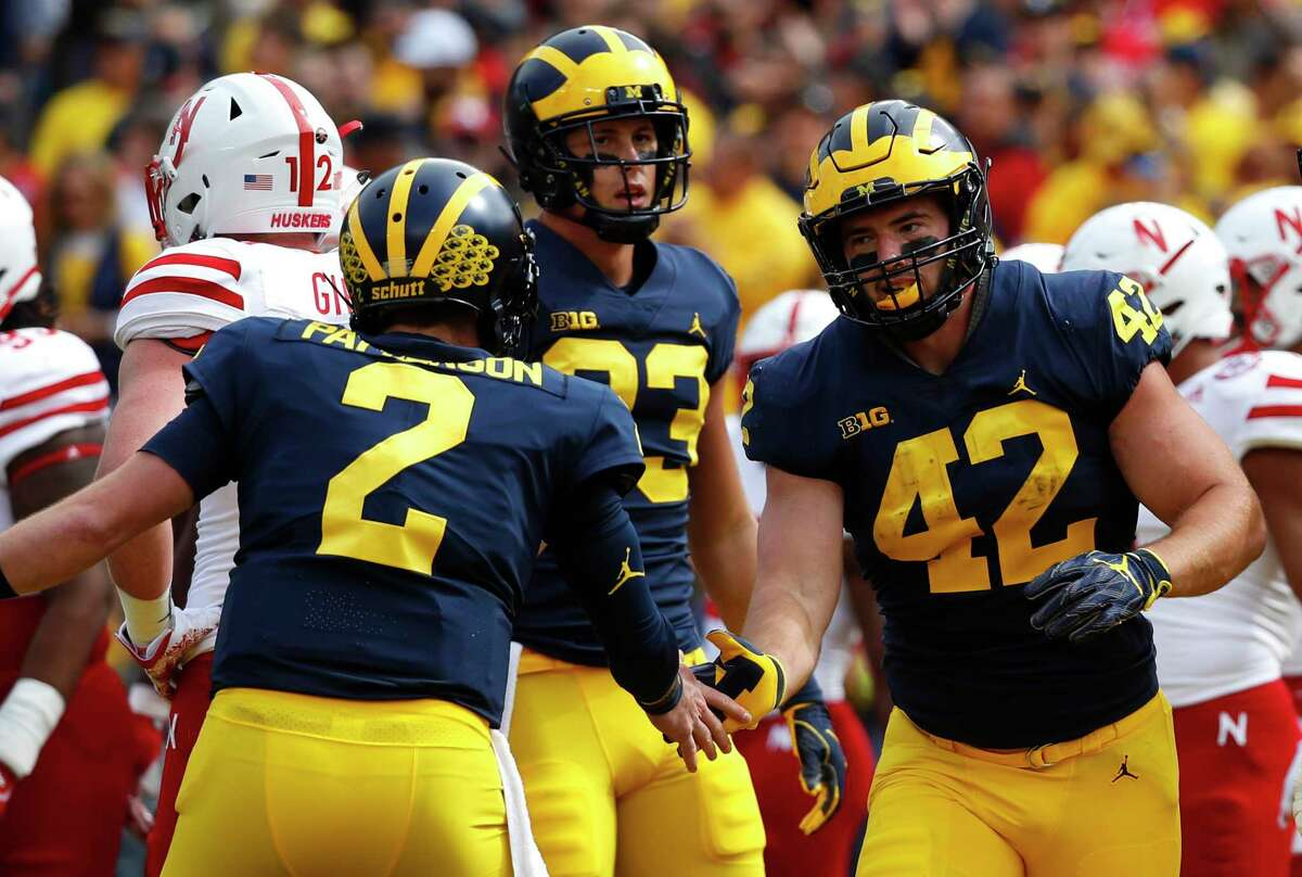 Michigan fullback Ben Mason (42) of Newtown celebrates his one-yard touchdown run with Shea Patterson (2) in the first half of the 2018 game against Nebraska. Mason was named to the Senior Bowl watch list.