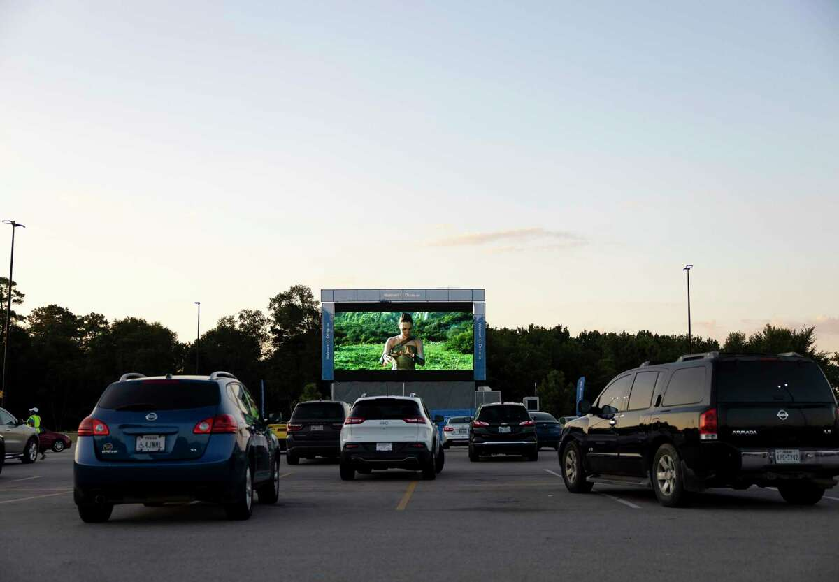 Vehicles are separated six-feet apart during a free drive-in theater showing of Wonder Woman at Walmart, Wednesday, August 19, 2020, in New Caney. Walmart started showing films in their parking lots after movie theaters closed their doors in late March due to the COVID-19 pandemic.