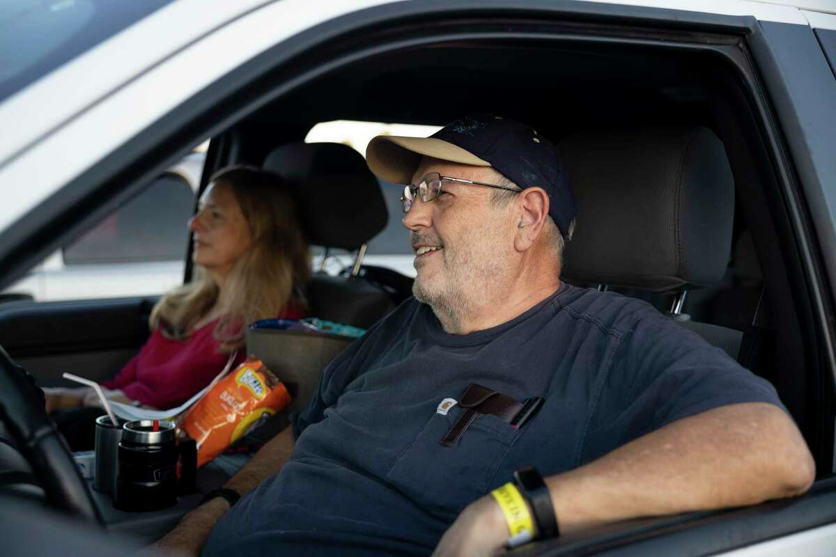 John and Deborah Thomas go out for a date night at a free drive-in theater showing of Wonder Woman at Walmart, Wednesday, August 19, 2020, in New Caney. The couple are retired teachers and have been following CDC recommendations throughout the COVID-19 pandemic.
