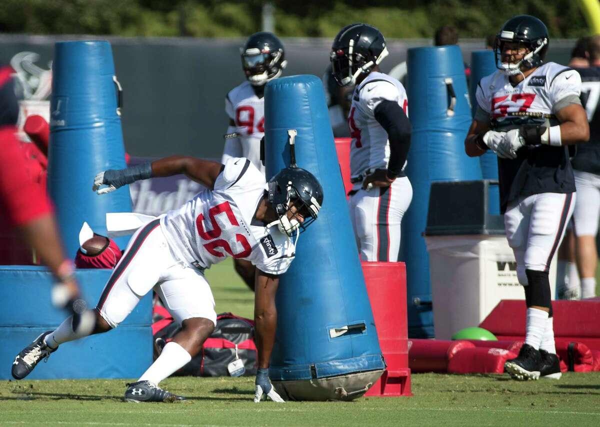 Houston Texans defensive end Jonathan Greenard (52) runs a drill during an NFL training camp football practice Thursday, Aug. 20, 2020, in Houston.