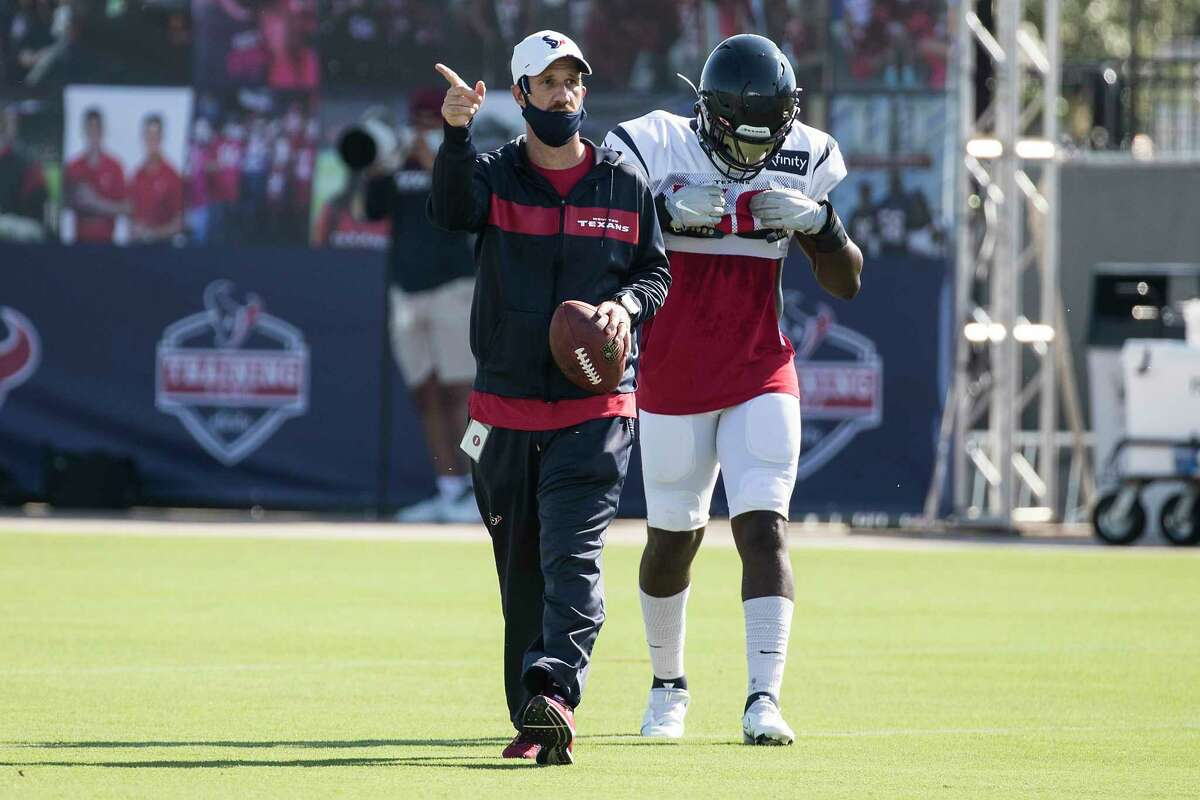 Houston Texans special teams coordinator Tracy Smith works with a kick team during an NFL training camp football practice Thursday, Aug. 20, 2020, in Houston.
