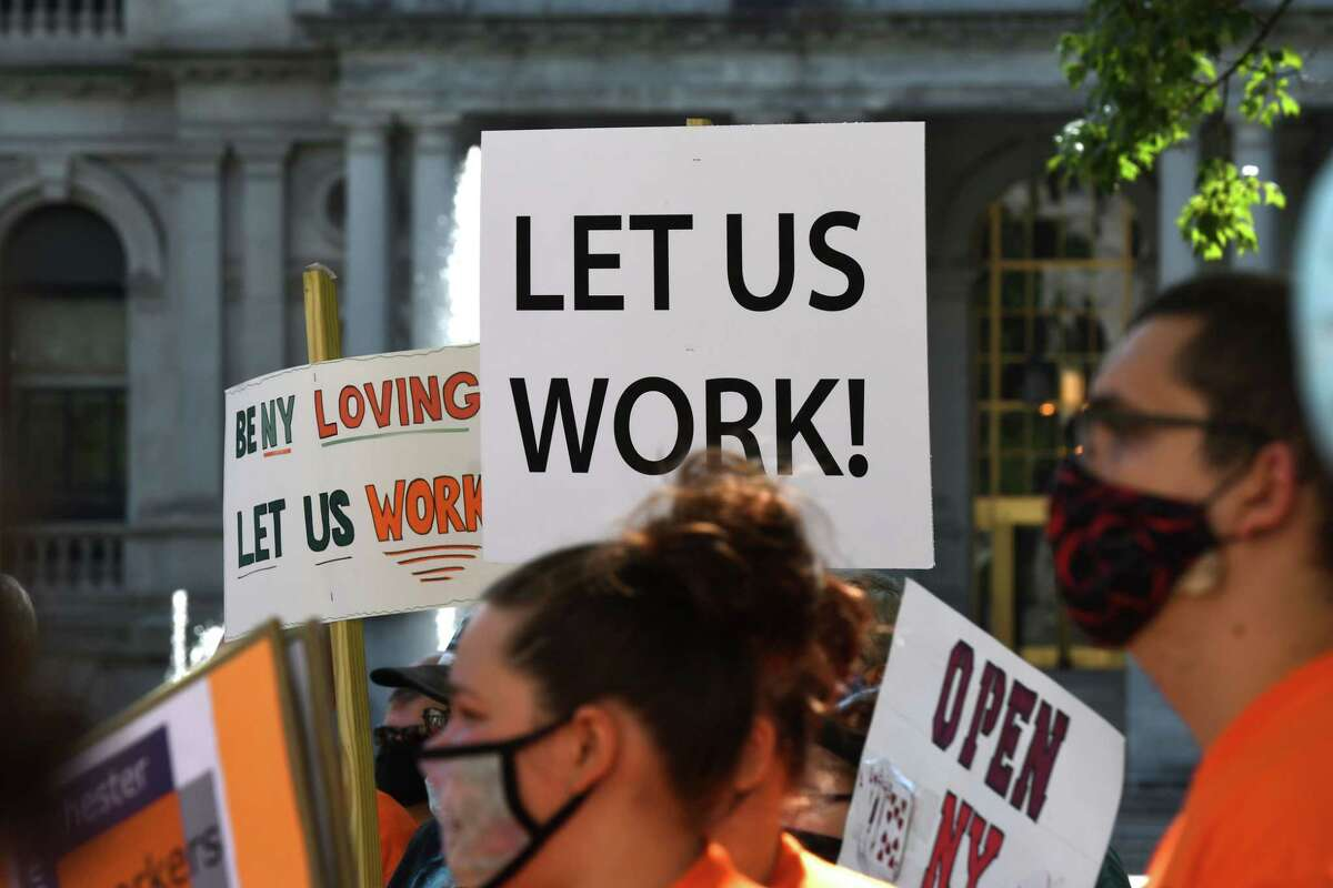 Casino workers rally outside the Capitol to call on Gov. Andrew Cuomo to reopen state casinos, which remain closed under coronavirus safety guidelines on Thursday, Aug. 20, 2020, in Albany, N.Y. (Will Waldron/Times Union)
