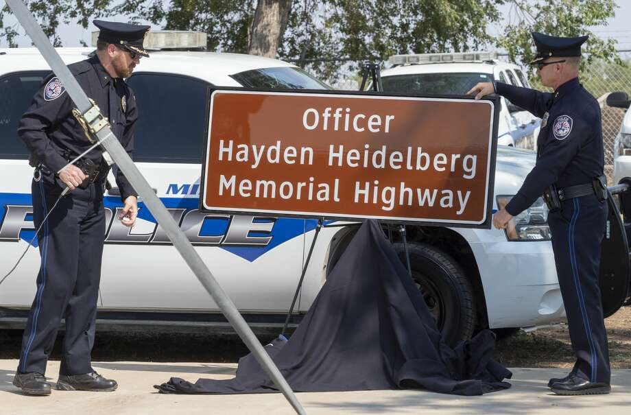 MPD Deputy Chief Greg McCright and Chief Seth Herman unveil the Hayden Heidelberg Memorial Highway sign 8/20/2020 at the Midland Police training center. Tim Fischer/Reporter-Telegram Photo: Tim Fischer/Midland Reporter-Telegram