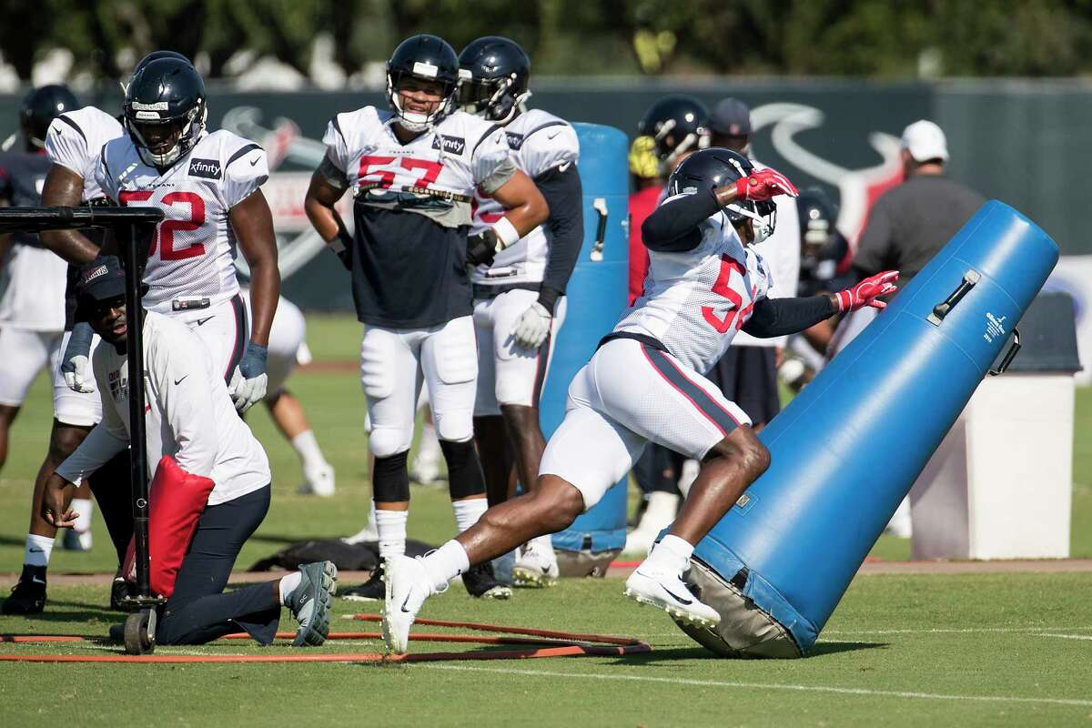 Houston Texans linebacker Jacob Martin (54) hits a blocking dummy as he runs a drill during an NFL training camp football practice Thursday, Aug. 20, 2020, in Houston.