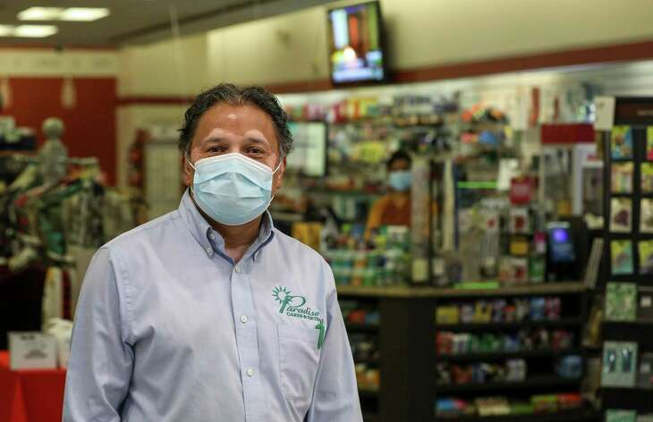 Charlie Patel, who runs Paradise Cards & Gifts, poses for a portrait in his store Tuesday, Aug. 4, 2020, in the downtown tunnels in Houston.