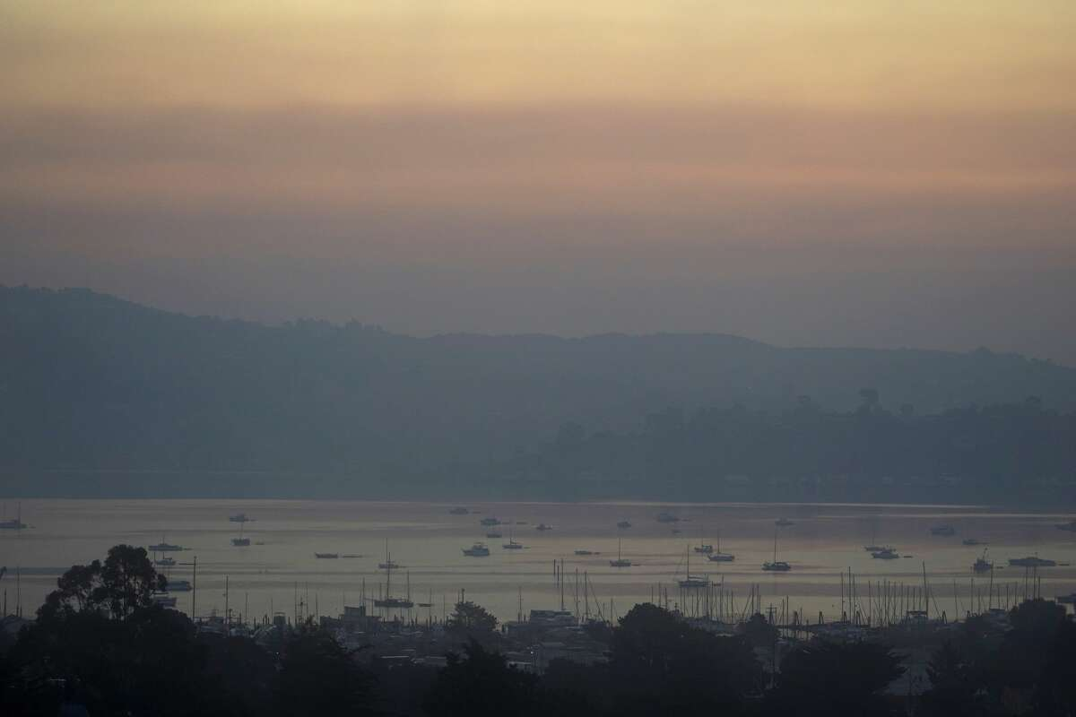 Smoke from wildfires hovers over Richardson Bay Thursday, Aug. 20, 2020, in Sausalito, Calif.