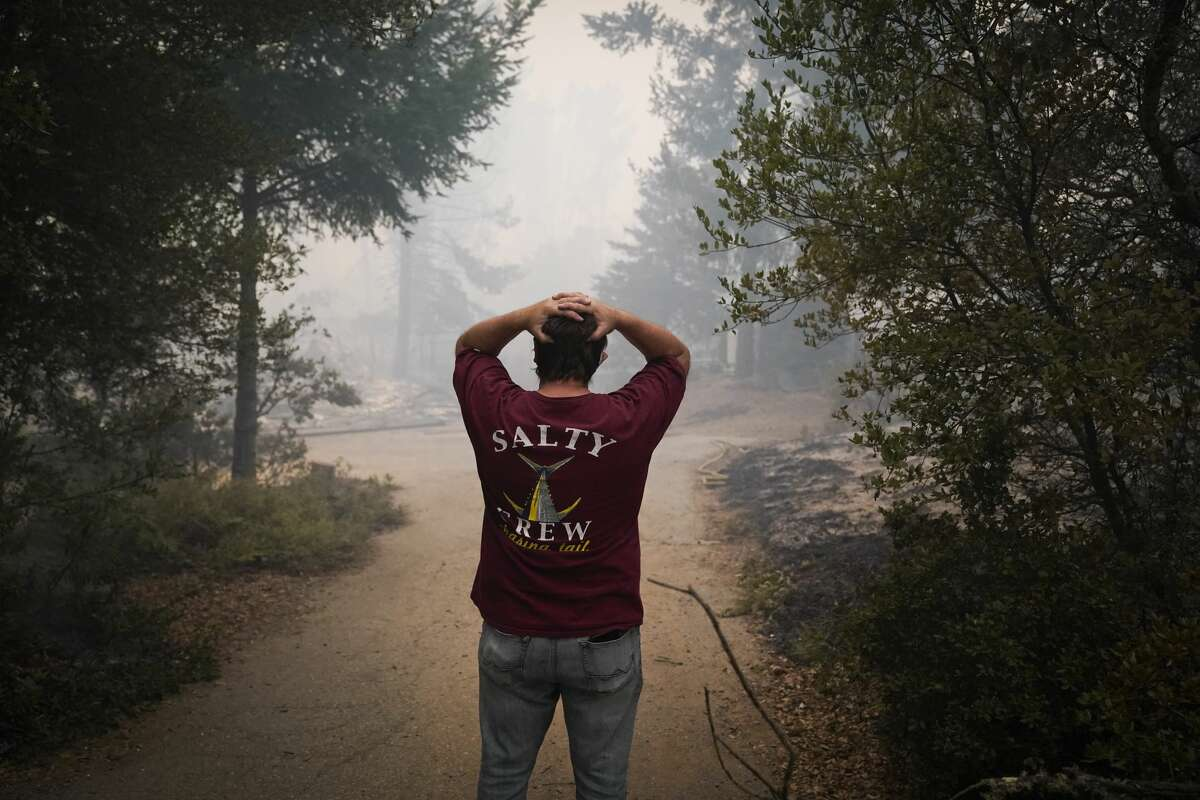 Peter Koleckar reacts after seeing multiple home burned in his neighborhood after the CZU August Lightning Complex Fire passed through on Thursday, Aug. 20, 2020, in Bonny Doon, Calif.