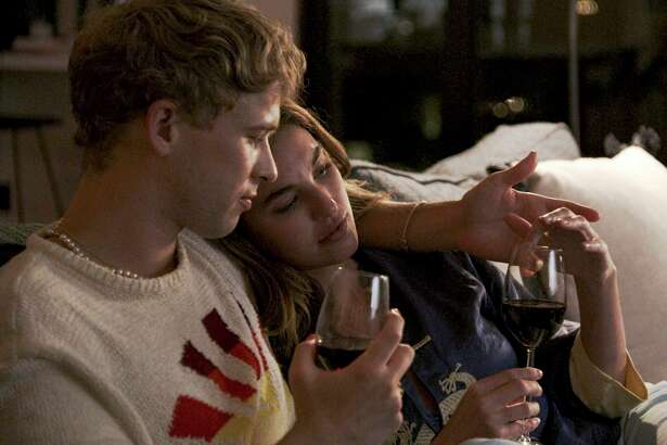 """Tommy Dorfman, left, and Rainey Qualley in a scene from """"Love in the Time of Corona,"""" a two-part series airing Aug.22 and 23 on Freeform, before it moves to Hulu."""