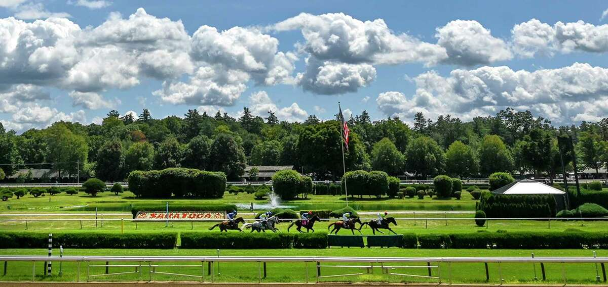 Thoroughbreds finish a race at Saratoga Race Course in Saratoga Springs, N.Y. A technical glitch forced the New York Racing Authority to delay the start of racing on Friday. Photo by Skip Dickstein/Special to the Times Union