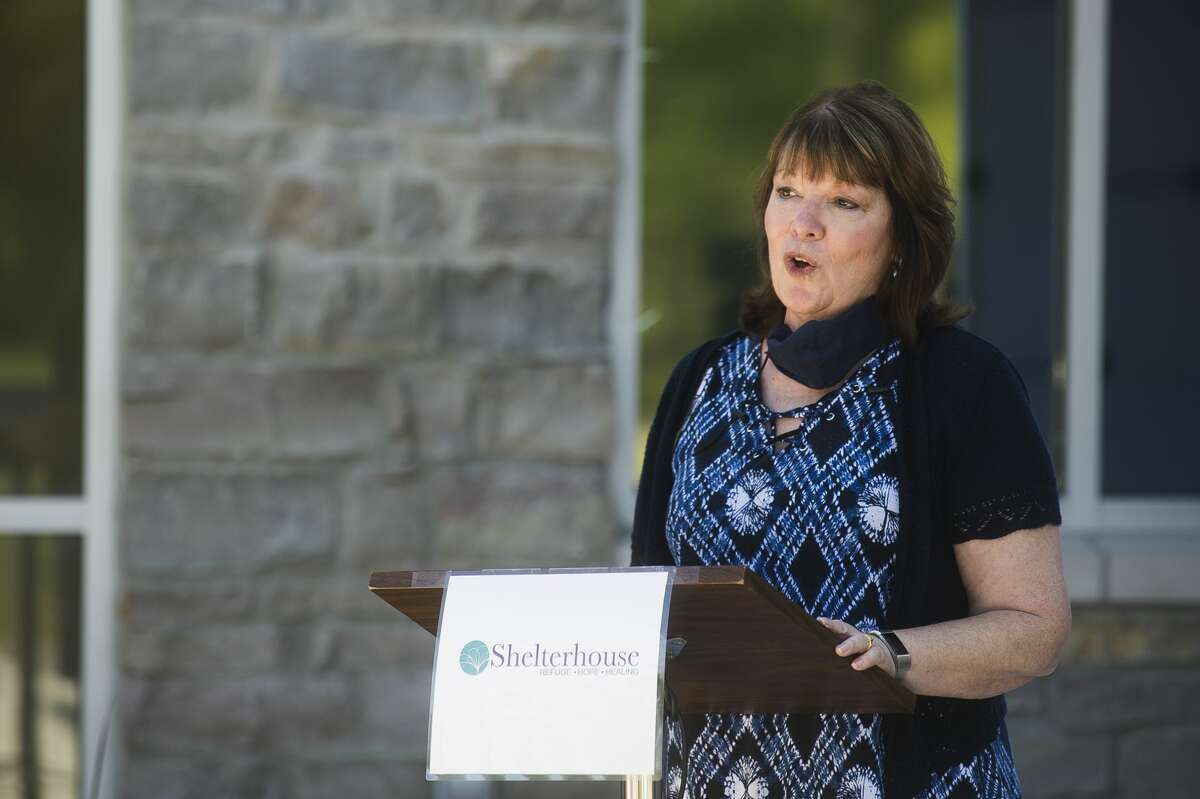 Shelterhouse Executive Director Janine Ouderkirk addresses a crowd of supporters during a ribbon cutting ceremony for Shelterhouse's new facility at 2500 Waldo Rd. Thursday, Aug. 20, 2020 in Midland. (Katy Kildee/kkildee@mdn.net)