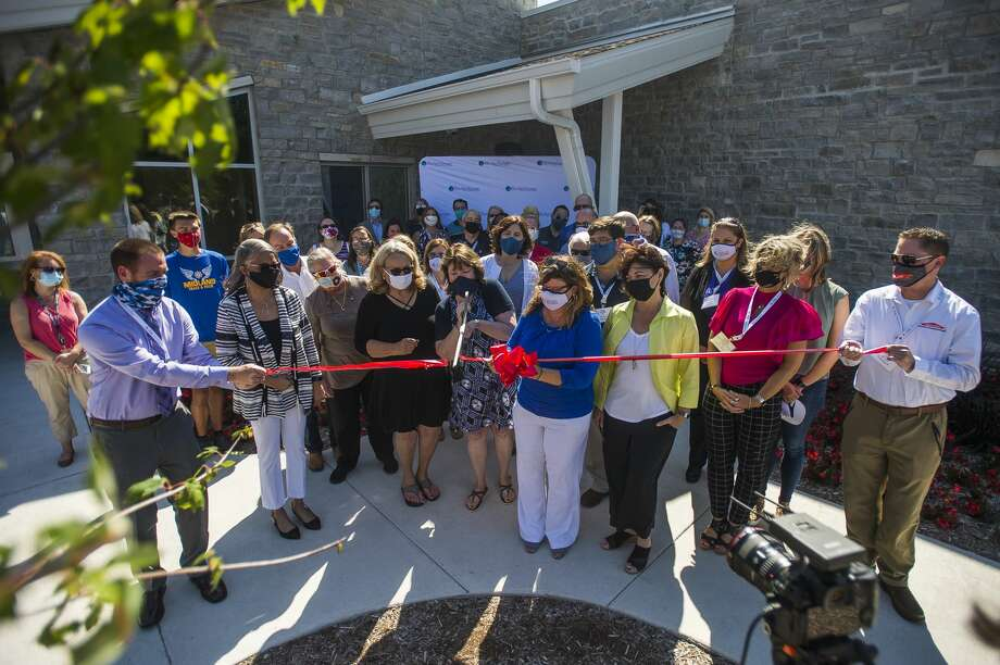 Members of the Midland Business Alliance, Shelterhouse staff and benefactors attend a ribbon cutting ceremony at Shelterhouse's new facility at 2500 Waldo Rd. Thursday, Aug. 20, 2020 in Midland. (Katy Kildee/kkildee@mdn.net) Photo: (Katy Kildee/kkildee@mdn.net)