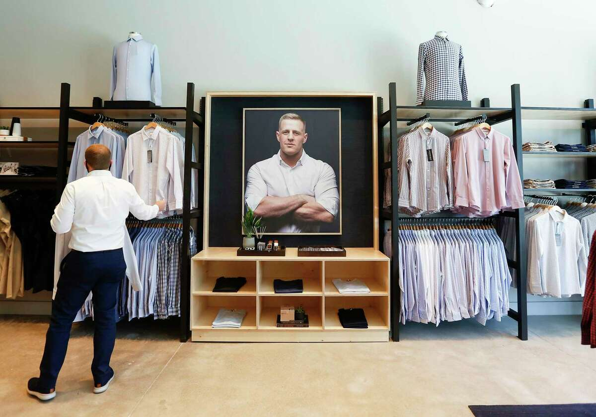 A shopper checks out a shirt at Mizzen+Main, a retailer of dress shirts and menswear made with performance fabric, opened at store recently at 707 Yale St. in the Heights on Wednesday, August 19, 2020.