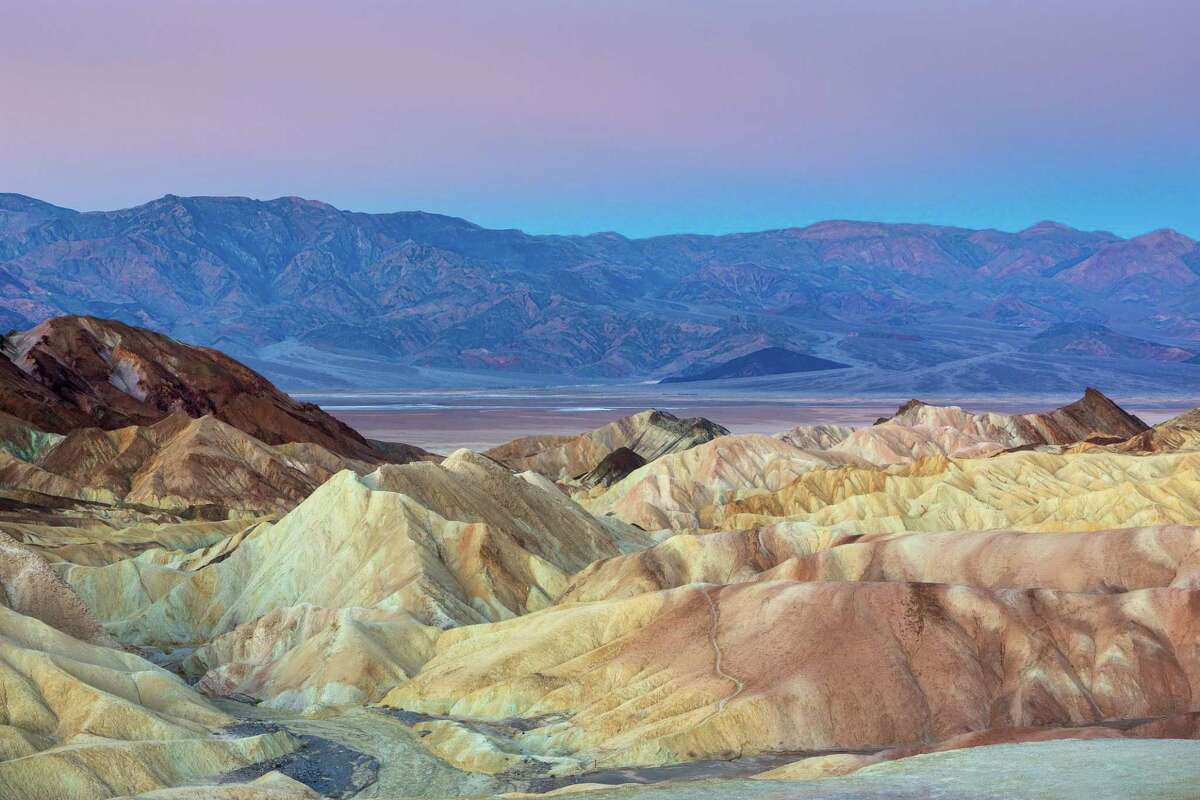 A hiker died Sept. 6 about 45 yards off a trail near Death Valley National Park's Zabriskie Point. Extreme heat appears to be a factor in the death, officials said.