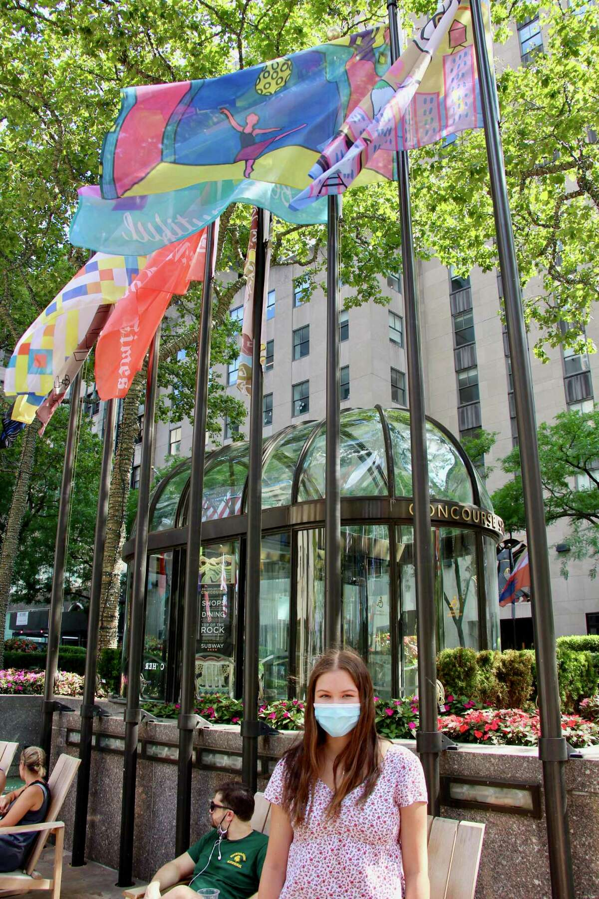 Emily Twitchell of New Canaan, who will be a junior at Greens Farms Academy in Westport, visited Rockefeller Center recently to see a flag she designed that was chosen for an exhibit there.