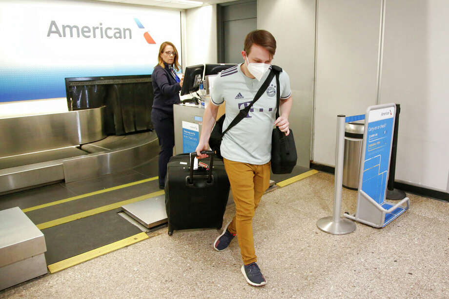 Ethan Cale walks from an American Airlines ticket counter. Photo: Rick Bowmer | AP / Copyright 2020 The Associated Press. All rights reserved