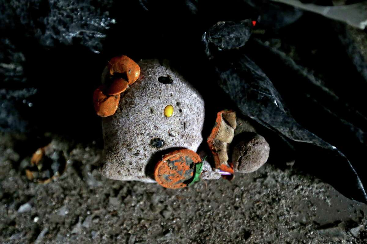 A Hello Kitty stuffed animal on the ground of Las Palmas II, along the 5600 block of Telephone Road, that was a former cantina and brothel, where Mexican and Central American women were held against their will, and subjected to beatings, rape and threats of further abuse if they didn't work as sex workers. Wednesday, Nov. 18, 2015, in Houston, Texas. They worked and lived in rooms above the bar, which was downstairs and drew thousands of customers. The site is one of the largest sex trafficking rings ever busted in Houston.