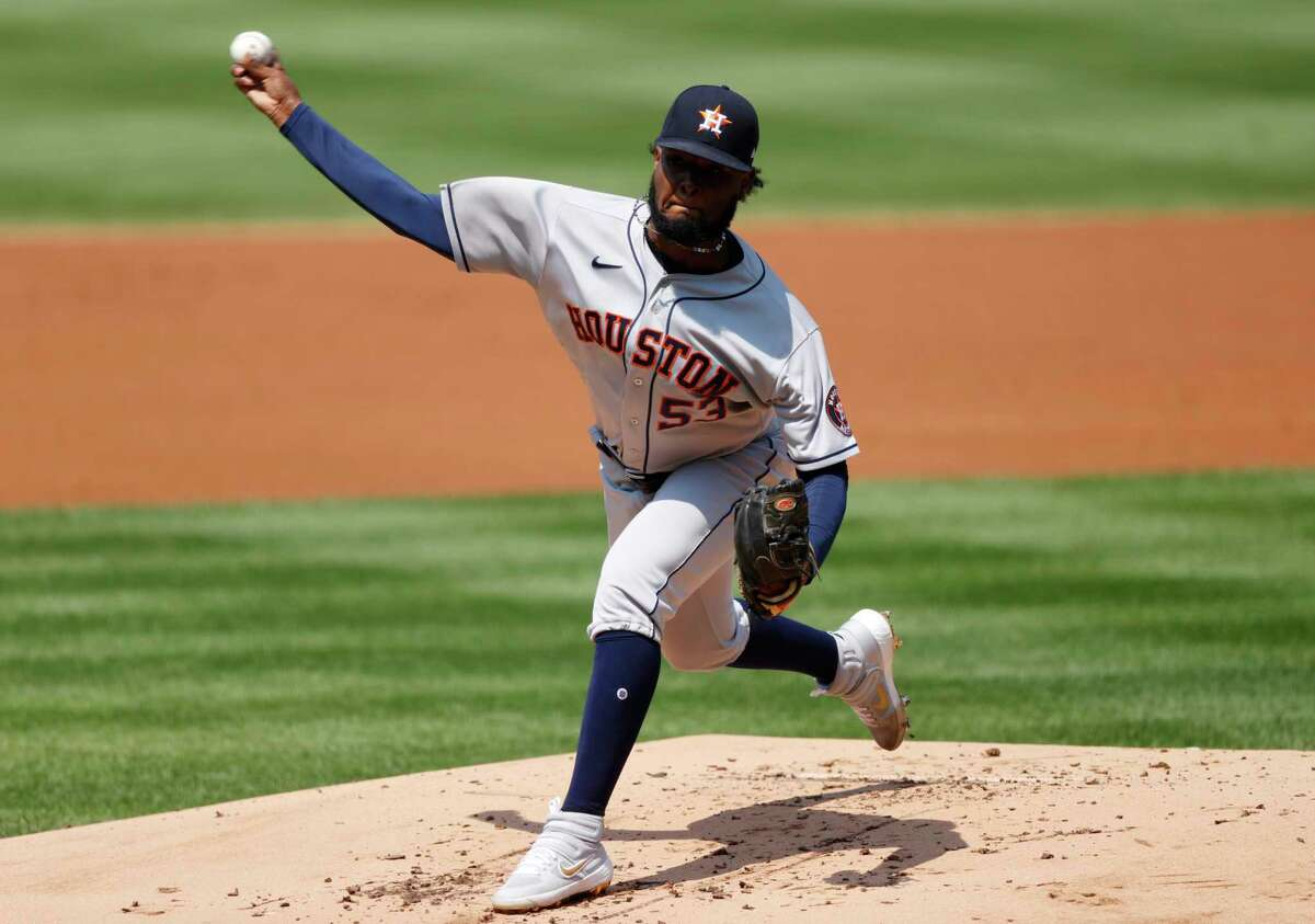 Houston Astros relief pitcher Cristian Javier works against the Colorado Rockies in the first inning of a baseball game Thursday, Aug. 20, 2020, in Denver. (AP Photo/David Zalubowski)
