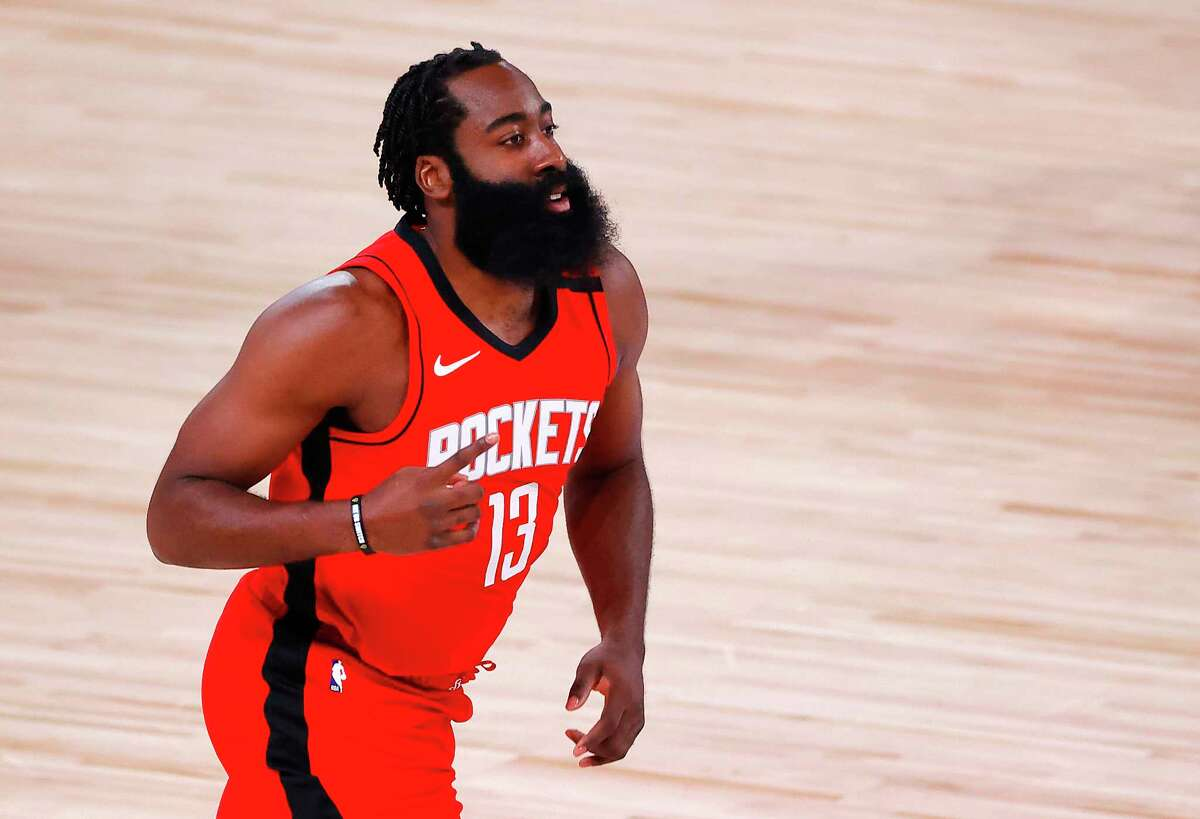 Houston Rockets' James Harden reacts to hi3 point basket during the first half against the Oklahoma City Thunder in Game 2 of an NBA basketball first-round playoff series, Thursday, Aug. 20, 2020, in Lake Buena Vista, Fla. (Kevin C. Cox/Pool Photo via AP)