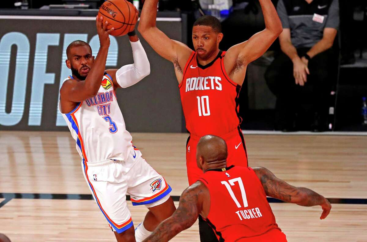 Oklahoma City Thunder guard Chris Paul (3) passes the ball against Houston Rockets guard Eric Gordon (10) and forward P.J. Tucker (17) during the first quarter of Game 2 of an NBA basketball first-round playoff series, Thursday, Aug. 20, 2020, in Lake Buena Vista, Fla. (Kevin C. Cox/Pool Photo via AP)