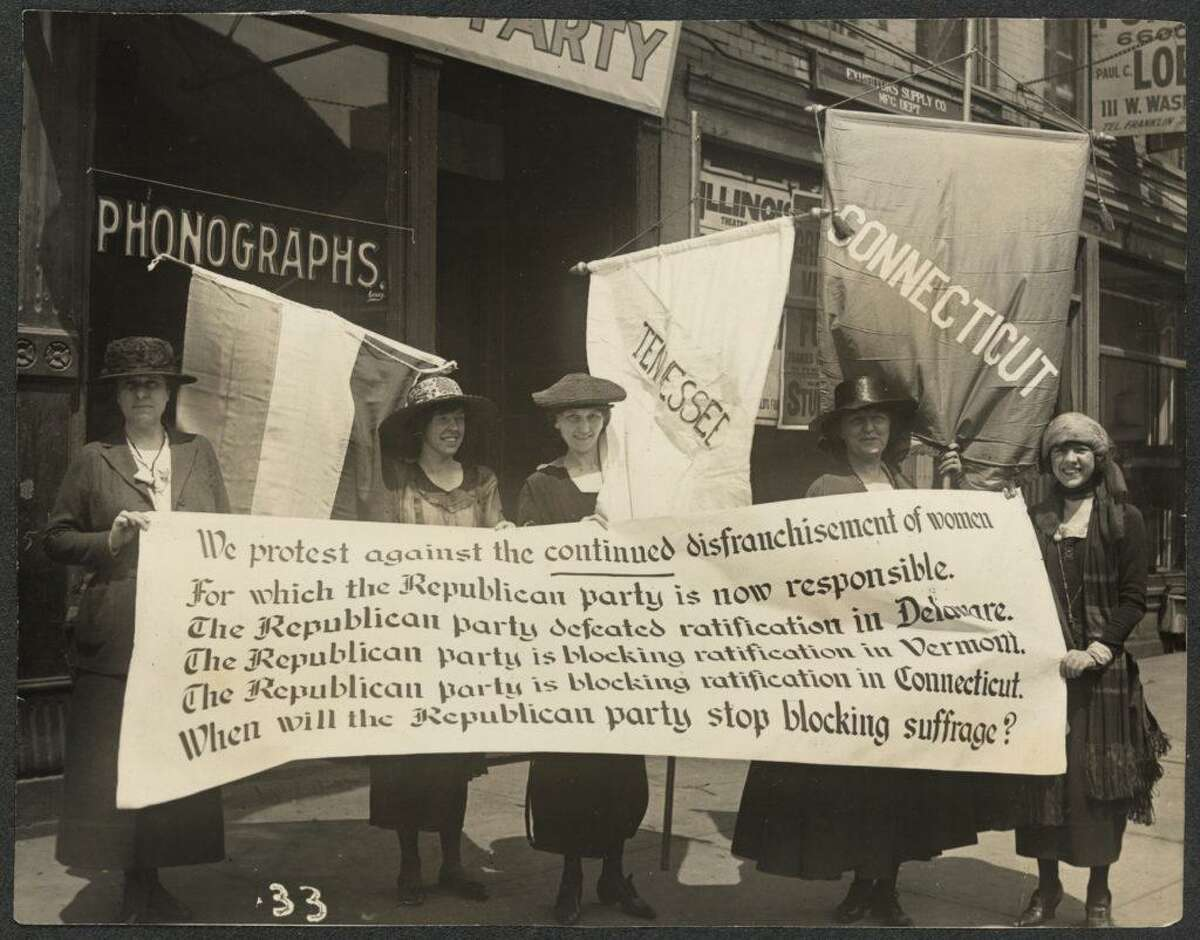 National Woman's Party members, including Elsie Hill of Connecticut (with banner), picketing the Republican National Convention, in Chicago, June 1920.