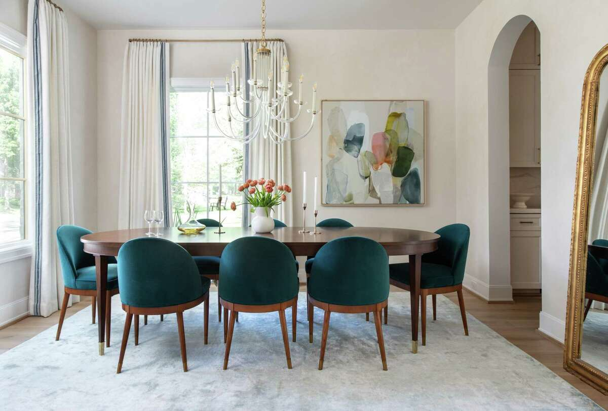Katie saw these chairs on a designer's Instagram feed and knew she had to have them -- in peacock blue -- for her own dining room.