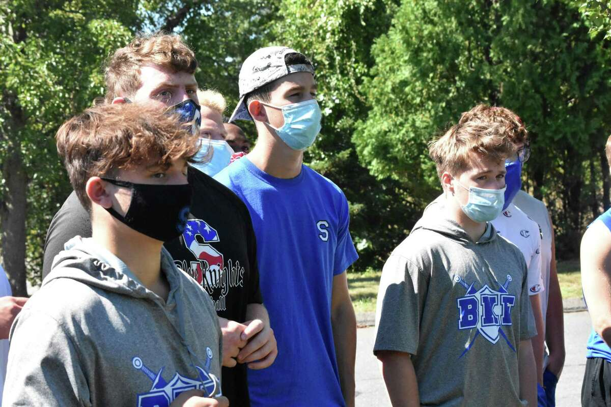 Members of the Southington football team watch as CIAC Executive Director Glenn Lungarini speaks to athletes and parents from multiple schools at the CIAC offices in Cheshire on Thursday.