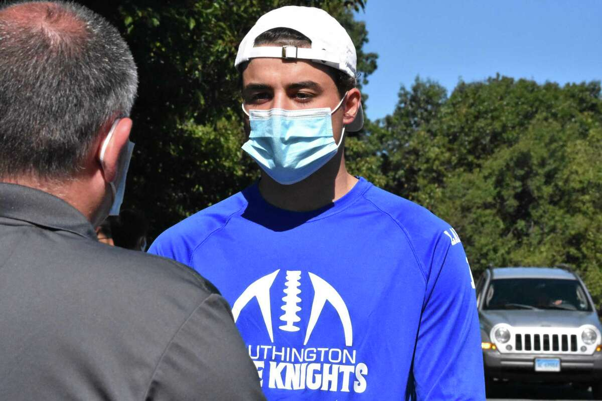 Southington quarterback Brady Lafferty speaks with CIAC Executive Director Glenn Lungarini at the CIAC offices in Cheshire on Aug. 20.