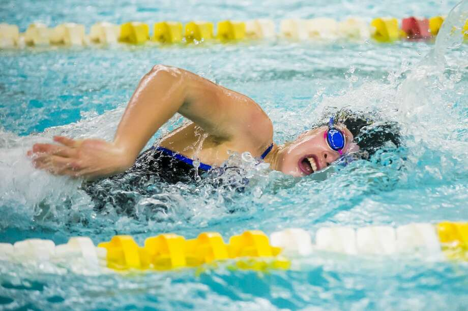 Midland High's Natalie Hoefer competes in the 100-yard freestyle during an Oct. 30, 2019 meet versus Dow High. Photo: Daily News File Photo