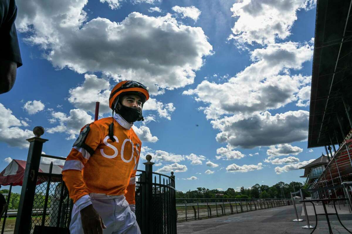 Jockey Luis Saez has his head in the clouds and a big mask obscured smile after winning the fifth race on the card with Leavuwithasmile Thursday Aug.20, 2020 at the Saratoga Race Course in Saratoga Springs, N.Y. This was one of at least 4 winners on the day for Saez. Photo by Skip Dickstein/Special to the Times Union