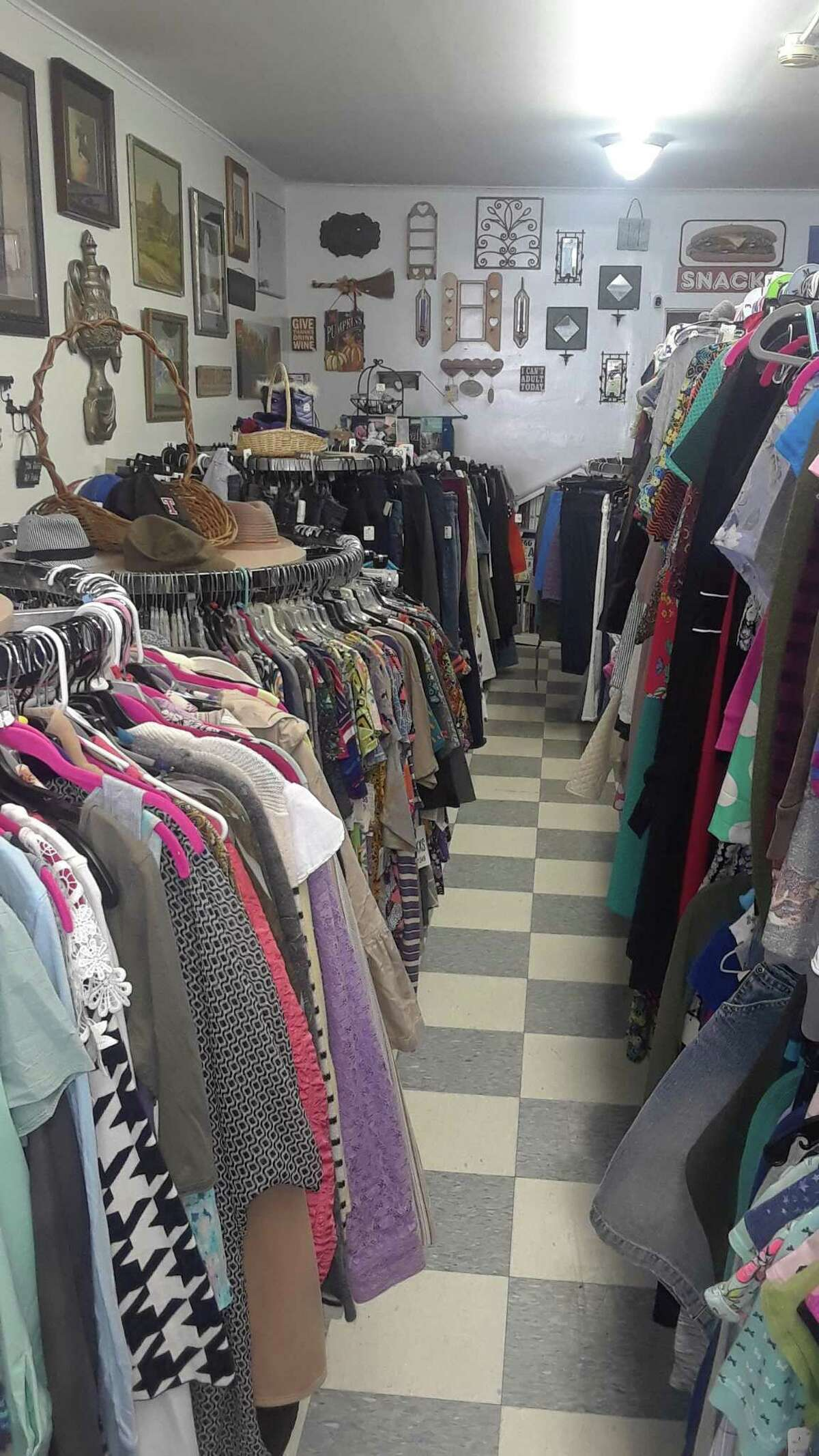 Clothing for women, men and children is displayed at The Goody Bag Variety and Consignment in Torrington, which opens Saturday on Main Street.