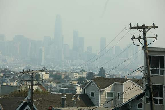 Wildfire smoke covers the skies seen looking toward downtown from 27th at Newburg streets on Wednesday, Aug. 19, 2020, in San Francisco, Calif.