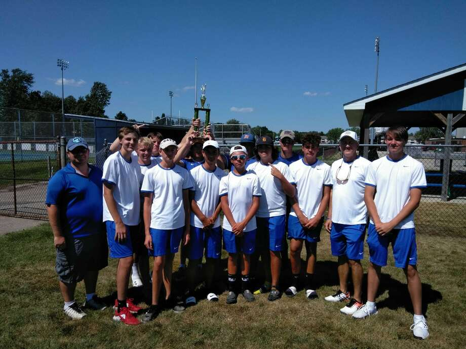 Midland High's boys' tennis team poses with the championship trophy after winning the Jim Teal Invitational on Thursday at Saginaw Heritage. Photo: Photo Provided
