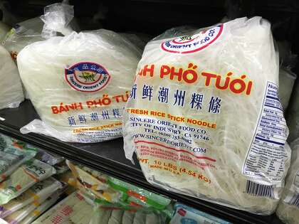 Fresh rice noodles for pho are available at Asia Supermarket in 10-pound bags.