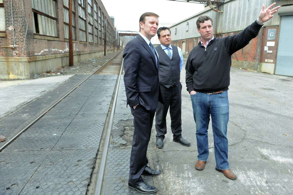 John Barto, right, site manager for the Ansonia Copper & Brass property, leads a tour for U.S. Senator Christopher Murphy, left, and Ansonia Mayor David Cassetti in Ansonia, Conn. March 23, 2016.