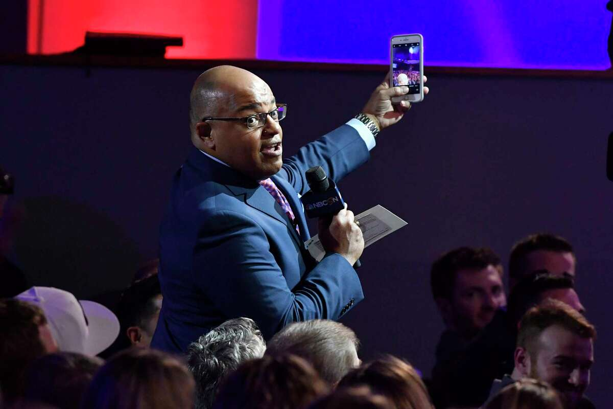 WASHINGTON, DC - APRIL 26: Mike Tirico takes a selfie with the audience during the Team USA Awards at the Duke Ellington School of the Arts on April 26, 2018 in Washington, DC. (Photo by Larry French/Getty Images for USOC)