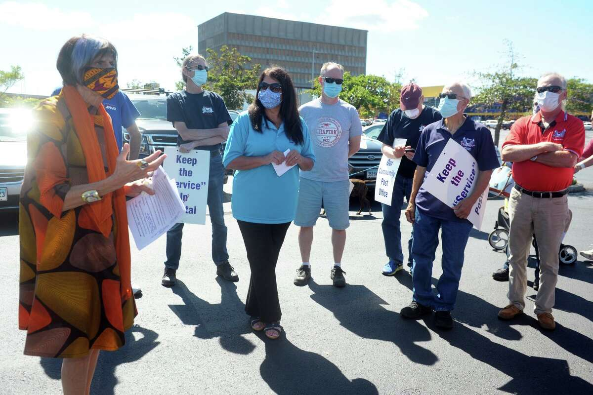 U.S. Rep. Rosa DeLauro speaks to postal workers prior to a news conference across the street from the General Post Office in New Haven, Conn. Aug. 20, 2020.
