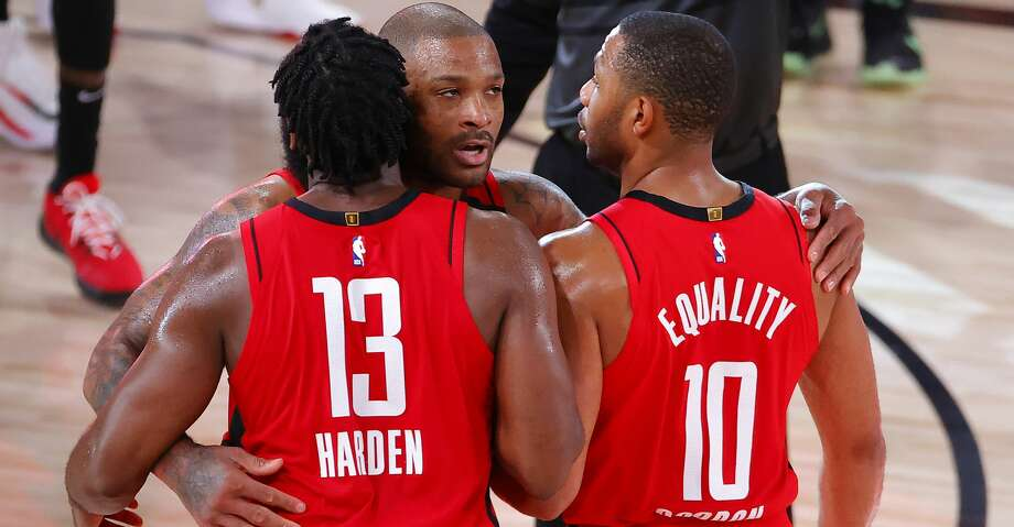 Houston Rockets' P.J. Tucker, center, James Harden (13) and Eric Gordon (10) celebrate their win over the Oklahoma City Thunder in Game 2 of an NBA basketball first-round playoff series, Thursday, Aug. 20, 2020, in Lake Buena Vista, Fla. (Kevin C. Cox/Pool Photo via AP) Photo: Kevin C. Cox/Associated Press / 2020 Getty Images