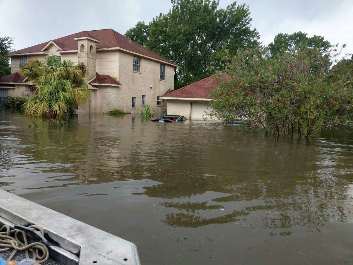 Flood waters rise into a League City home during Hurricane Harvey. Emergency management officials say that in 2020, residents need to factor in the coronavirus pandemic in their planning for potential bad weather.