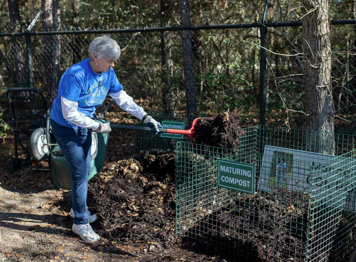 Christie Kennedy, a 6 year volunteer with the Montgomery County Master Gardeners Association, turns over a compost bin, Saturday, Jan. 4, 2020. Kennedy has been composting for over 60 years.