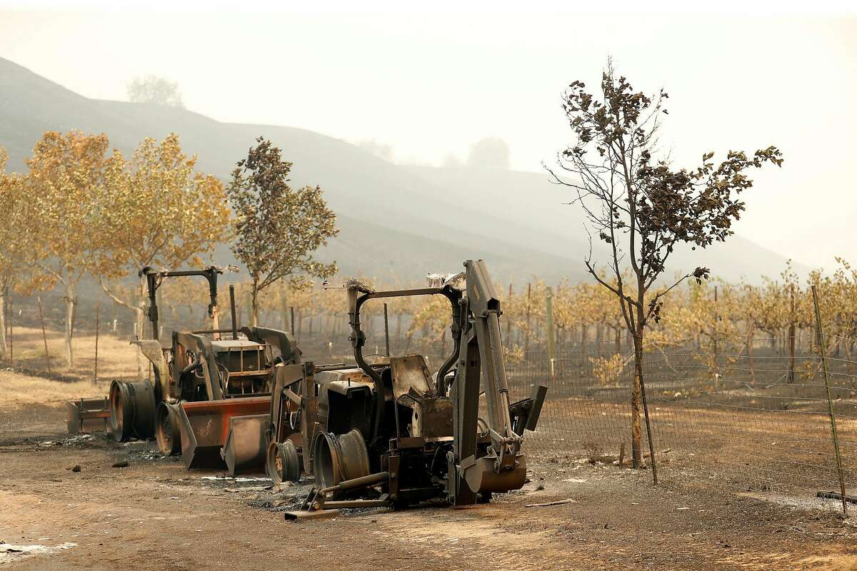 Burnt farm machinery at La Borgata Winery and Distillery after LNU Lightning Complex fire burned in Vacaville, Calif., on Thursday, August 20, 2020.