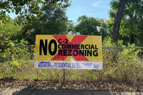 "Signs peppering yards and fences in the Government Hill neighborhood proclaim ""No C-2 commercial rezoning, neighbors for residential development only"" and ""Don't kill Gov't Hill."""