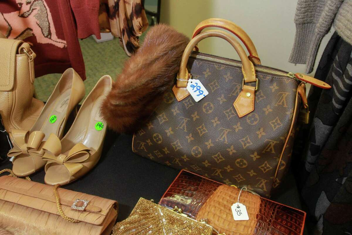 A Louis Vuitton Speedy 25 handbag and pair of Valentino heels on display at the Salvation Army's annual chic boutique in Houston on August 18, 2020.