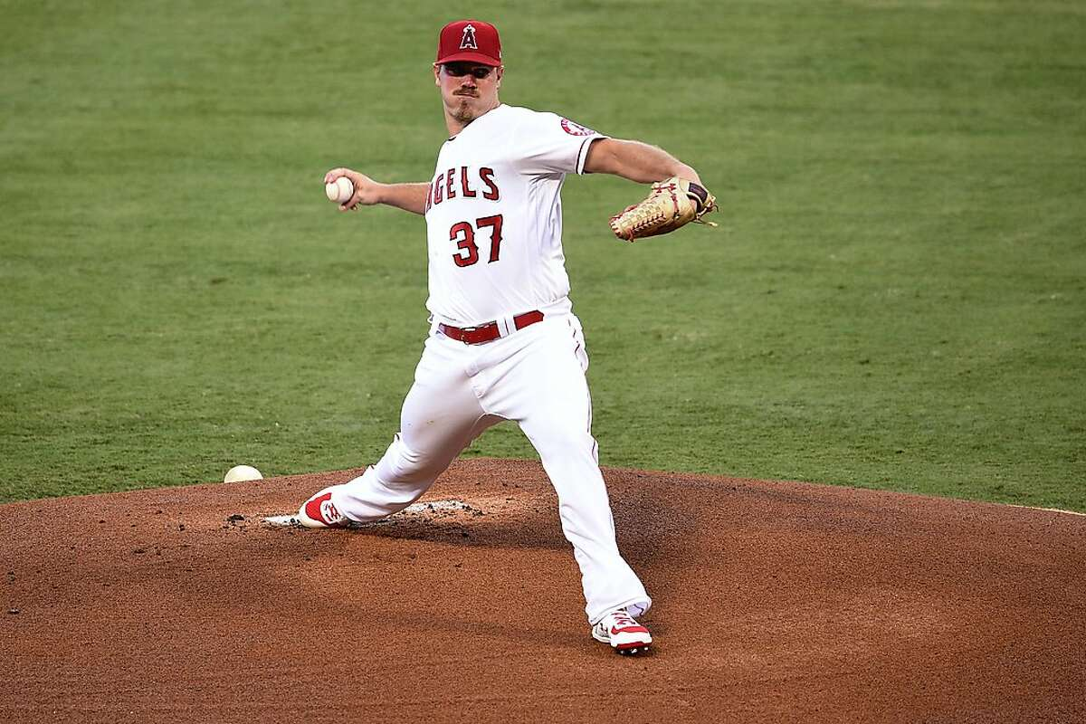 Los Angeles Angels starting pitcher Dylan Bundy delivers a pitch during the first inning of a baseball game against the Oakland Athletics in Anaheim, Calif., Tuesday, Aug. 11, 2020. (AP Photo/Kelvin Kuo)