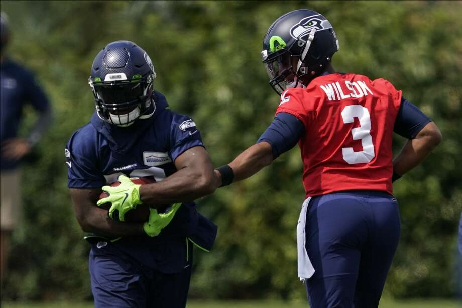 Seattle Seahawks offensive coordinator Brian Schottenheimer said he plans to get all four of the team's running backs carries in the season opener in Atlanta on Sunday. Photo: Ted S. Warren/AP / Copyright 2020 The Associated Press. All rights reserved.